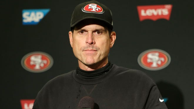 Jim Harbaugh talks to the media after the Seahawks defeated the 49ers 17-7 on Dec. 14, 2014.