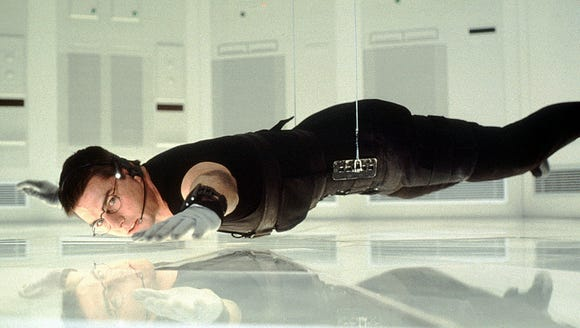 """Tom Cruise goes to extraordinary lengths to get information in the original """"Mission: Impossible."""""""