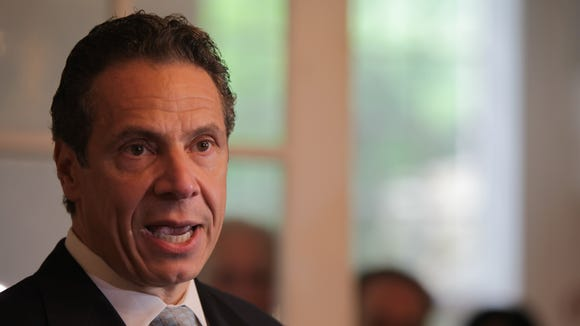 (file photo) Gov. Andrew Cuomo speaks to the media after voting in the Democratic primary at Mt. Kisco Presbyterian Church in Mount Kisco on Sept. 9, 2014