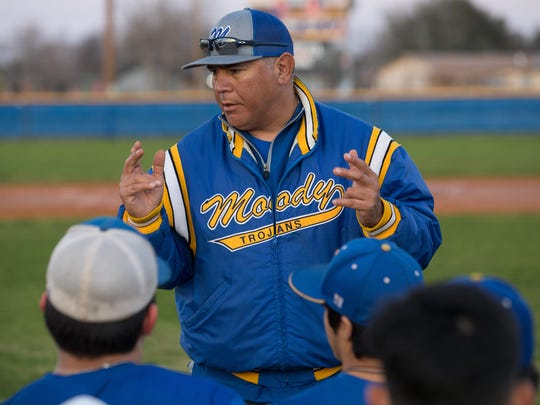 Moody coach Joe Curiel talks to his players during