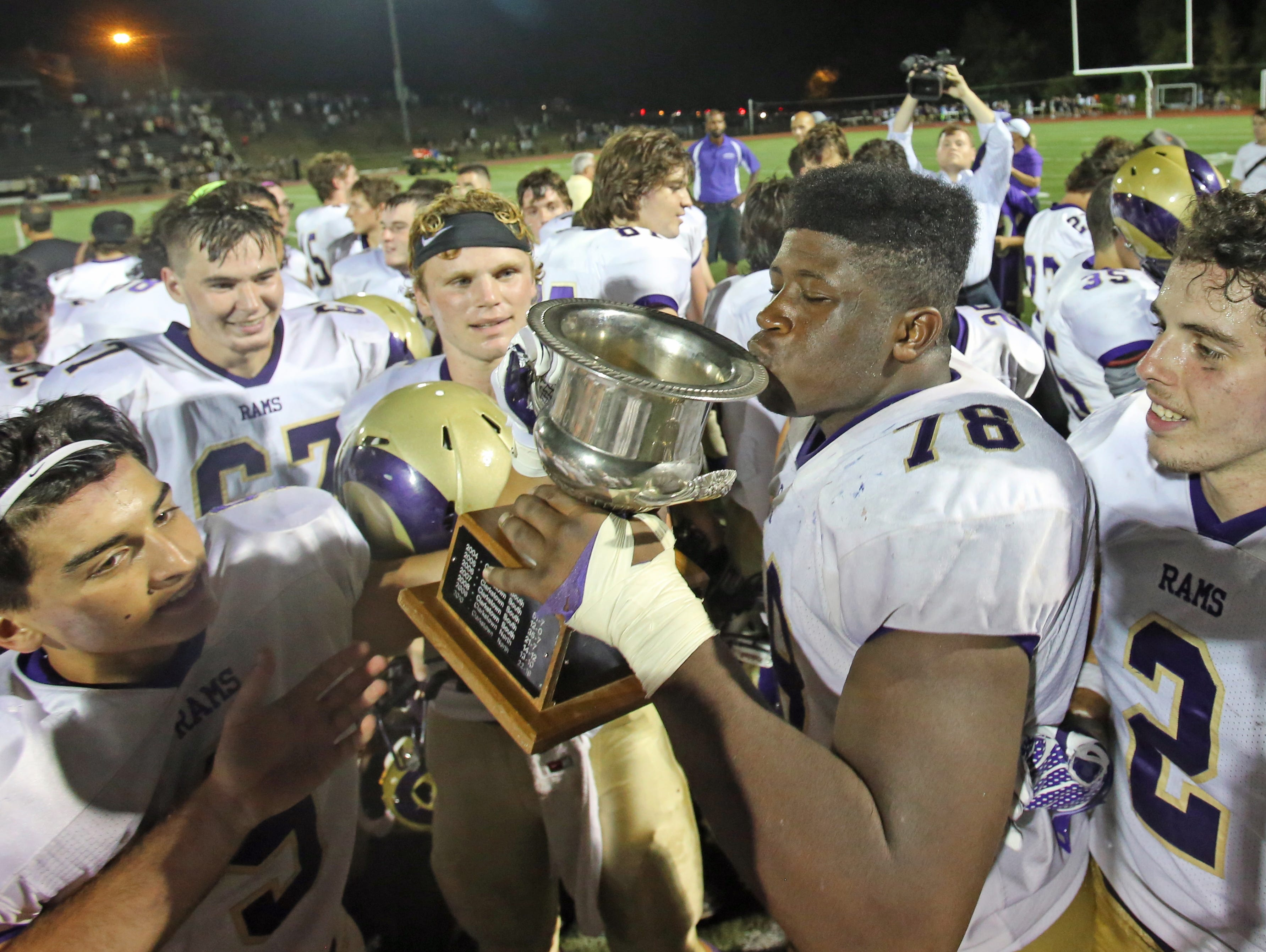 Clarkstown North celebrates their 26-8 win over Clarkstown South and winning Supervisor's Cup at Clarktown South High School in West Nyack Sept. 4, 2015.
