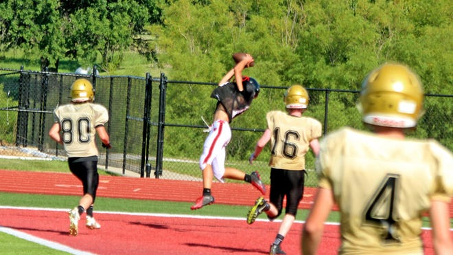 """Junior wide receiver Braxten Johnson of the 2020 Chillicothe High School football Hornets stretches out to make a leaping catch of junior quarterback Gage Leamer's pass for about a 20-yards touchdown, one of two the varsity offense scored against Trenton during last Friday's (Aug. 21, 2020) closed-to-fans 2-teams """"jamboree"""" scrimmage at CHS' Jerry Litton Memorial Stadium II. The Hornets plan to begin their season at Litton Stadium this Friday (Aug. 28), hosting Marshall in a 7 p.m. game."""