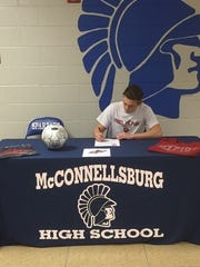 McConnellsburg's Jake Boehme signs his National Letter of Intent to play men's soccer at St. Francis on Wednesday.