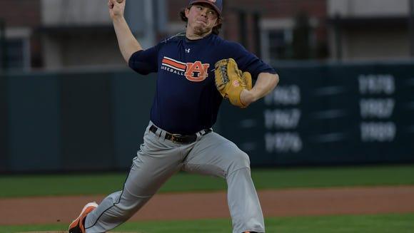 Keegan Thompson throws a pitch during Auburn baseball