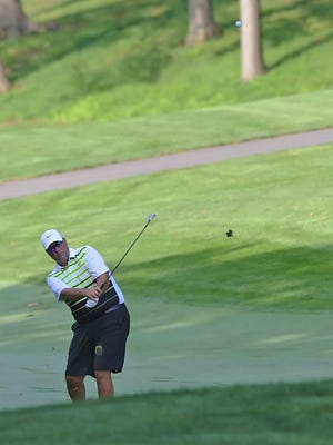 Brian Green lofts his ball out of a trap during semifinal play in the Men's City golf championship at Purdue on Saturday.