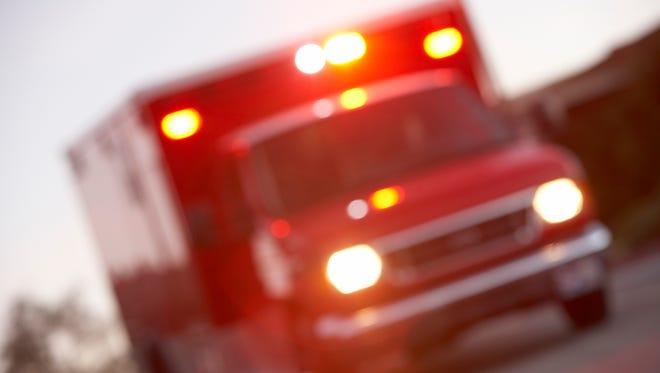 An ambulance on a street.