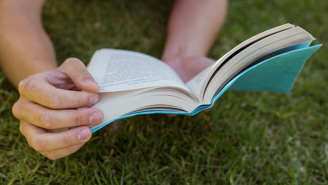Let's Take the Library Outside is a program encouraging residents to take their reading outdoors, to Pinchot Park.