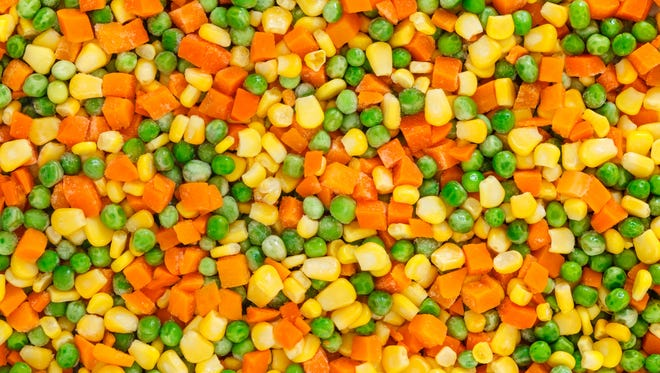 Frozen diced vegetables with carrot, corn and peas.