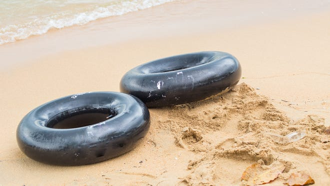 Stock photo of inner tubes on a beach.