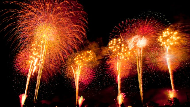 Fireworks exploding in sky, black background, long exposure, Tsuchiura city, Ibaragi prefecture, Japan