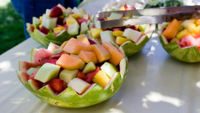 Some juicy fruit at a summer family potluck.