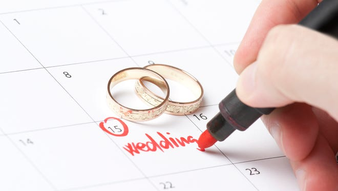 Wedding rings and hand writing word wedding into calendar  [url=http://www.istockphoto.com/my_lightbox_contents.php?lightboxID=12368626][img]http://www.jirsak.cz/data/lightboxes/concepts_1.jpg[/img][/url]  [url=http://www.istockphoto.com/my_lightbox_contents.php?lightboxID=8970201][img]http://www.jirsak.cz/data/lightboxes/hand.jpg[/img][/url]