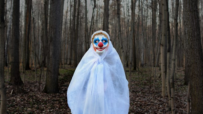 Stock image of an evil clown in a mask.