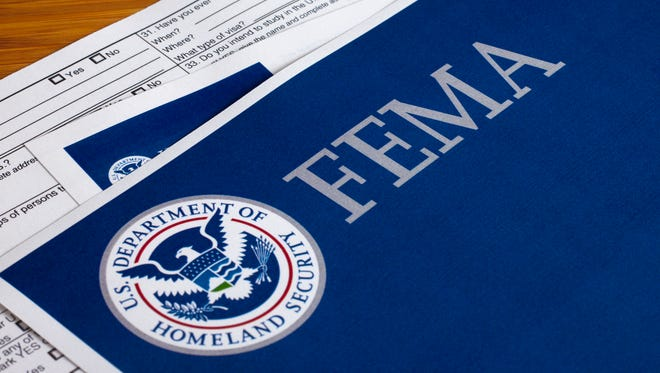 A close up of a FEMA US Homeland Security Citizen and Immigration Services flyer.