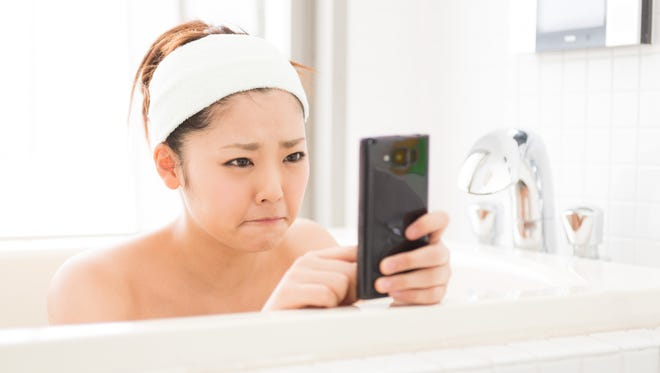 No, using your cell phone in the bathtub won't kill you, but it doesn't make it a good idea.