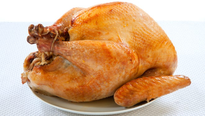 Mouth-watering golden roasted turkey over white background, no garnish..
