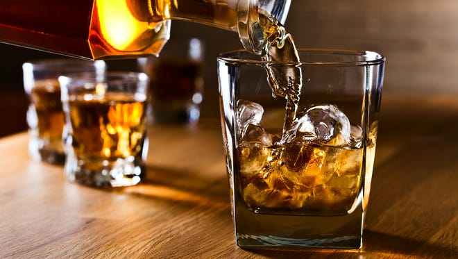 What is the physiological basis of drinking whiskey to break a fever?