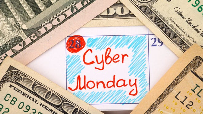 Reminder Cyber Monday in calendar with dollar banknotes