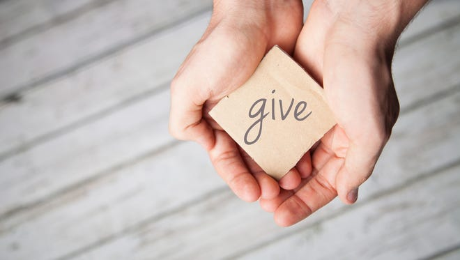 Two hands offering to donate.