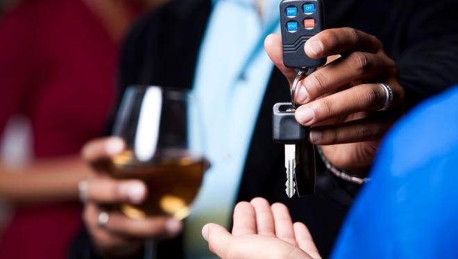Handing over keys while drinking