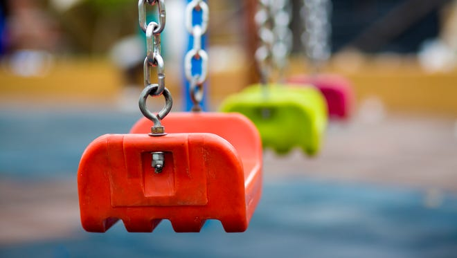 Close up of plastic swing in playground.