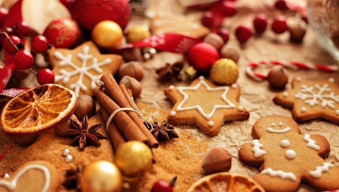 Gingerbread cookies are a popular treat during the holidays. christmas baking ingredients - christmas gingerbread cookies, spices, nuts and fruits
