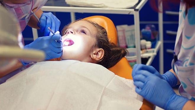 Little girl at the dentist.