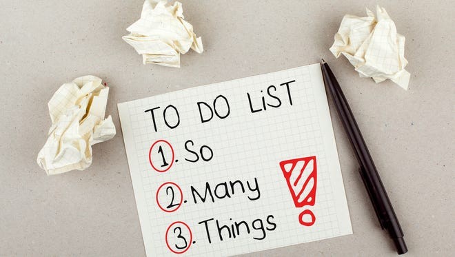 To do list with so many things note on paper with paper balls and pen