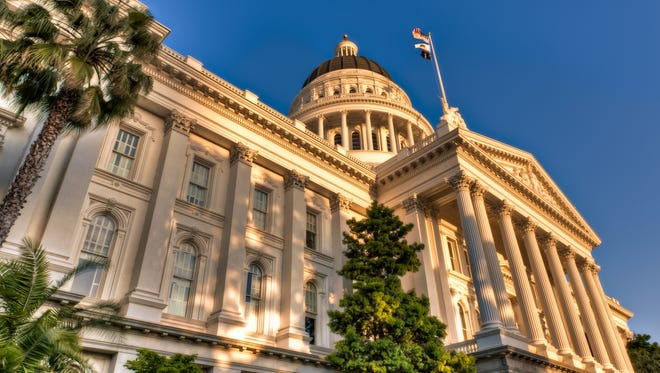California State Capitol building in the warm light of the setting sun.