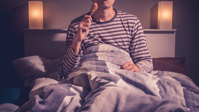 Late-night eating, while a comfort, may be bad for you.