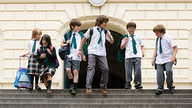 A group of British boys are protesting their school's school uniform rules by wearing skirts to school.
