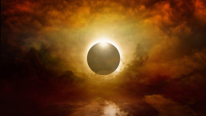 Dramatic apocalyptic background - full solar eclipse in dark red sky, end of world, judgment day coming. Elements of this image furnished by NASA