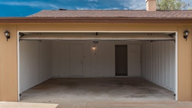 Open garage door under blue sky