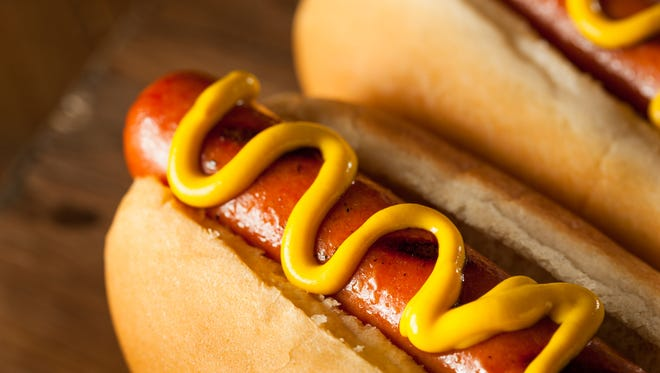 Barbecue grilled hot dog with yellow mustard.