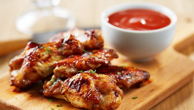 Chicken wings with sriracha sauce.