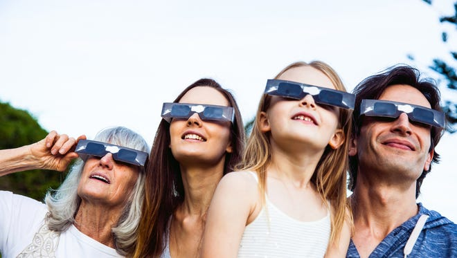 Solar glasses help people view the eclipse safely.