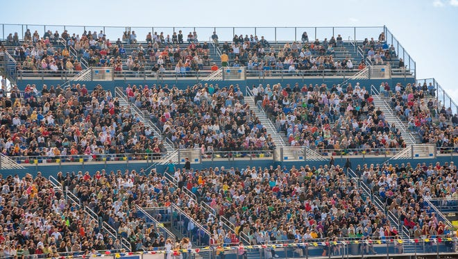 A large crowd at a football stadium.