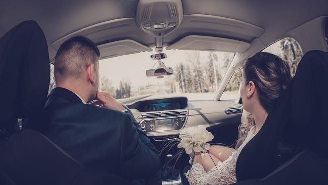 A couple in the car.