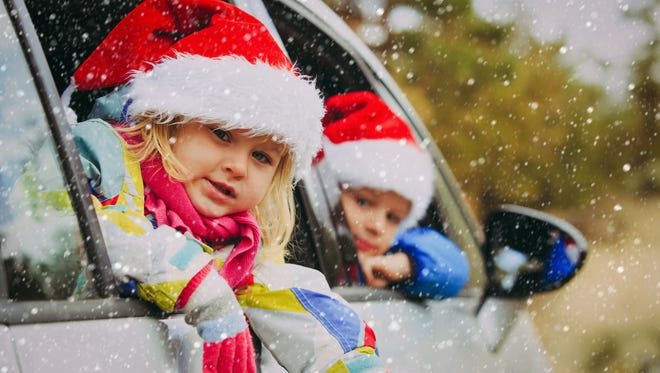 christmas car travel- happy kids travel in winter nature