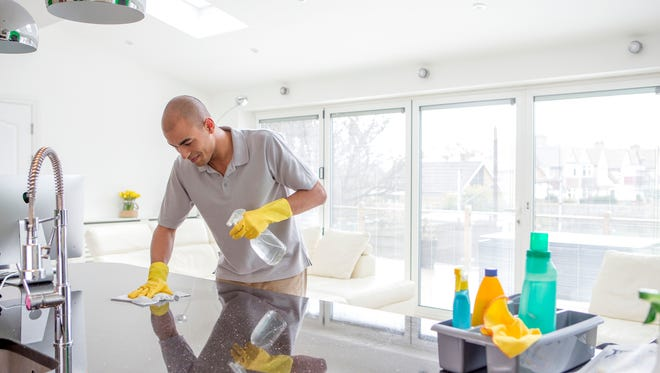 Man cleaning kitchen.