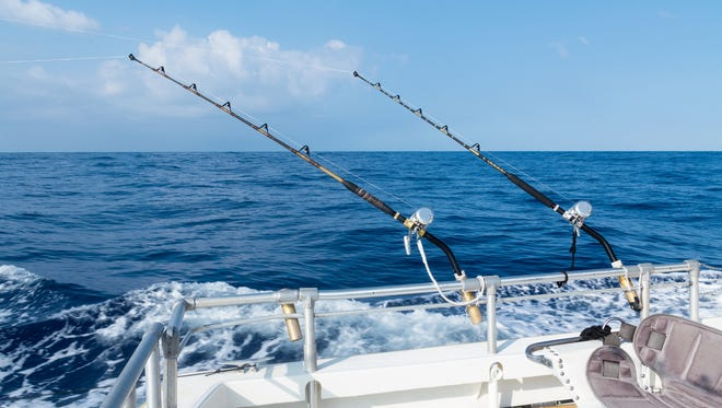 Sport fishing with two salt water rods and reels