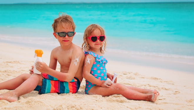 Just like that oxygen mask on an airplane, consider children first when it comes to applying sunblock and reapply throughout a beach or pool day.
