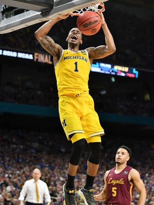 Michigan guard Charles Matthews dunks late in the second half in Michigan's win over Loyola-Chicago.