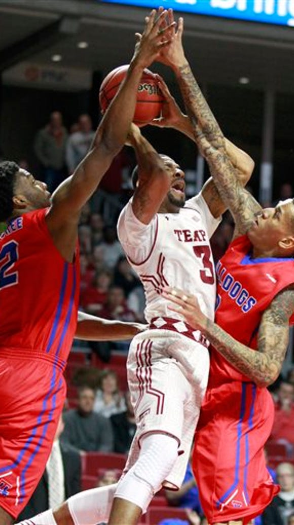 Temple's Jesse Morgan, center, gets fouled between