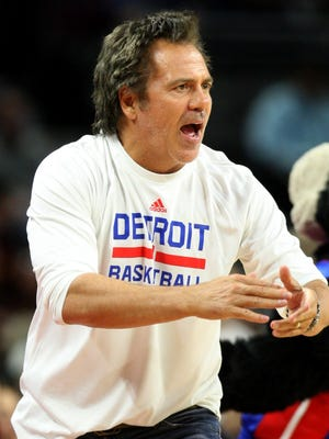Pistons owner Tom Gores encourages the team during the third period of the Pistons' loss Tuesday at the Palace.