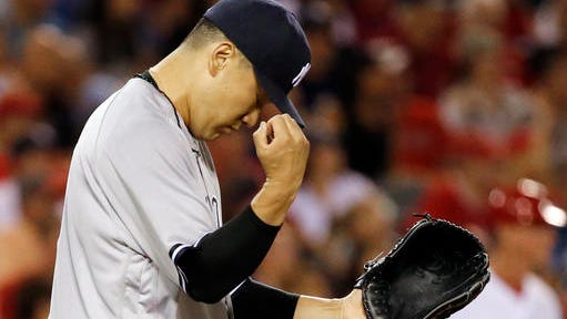 New York Yankees pitcher Masahiro Tanaka, of Japan, reacts after a long fly ball to center field by Los Angeles Angels' Kole Calhoun was caught during the fourth inning of a baseball game in Anaheim, Calif., Friday, Aug. 19, 2016.