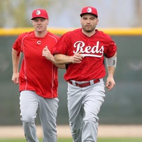 Reds right fielder Jay Bruce, left, and first baseman Joey Votto, right, jog during warmups at spring training