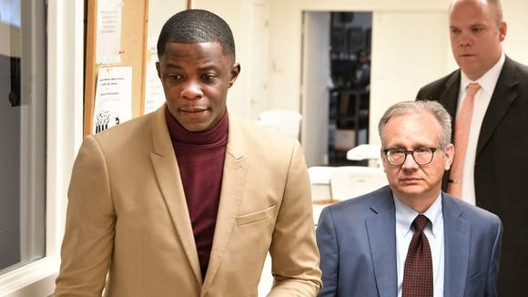 James Shaw Jr., 29, left, walks with Mayor David Briley after church services. Shaw disarmed a shooter at the Antioch Waffle House. Sunday in Nashville, Tenn