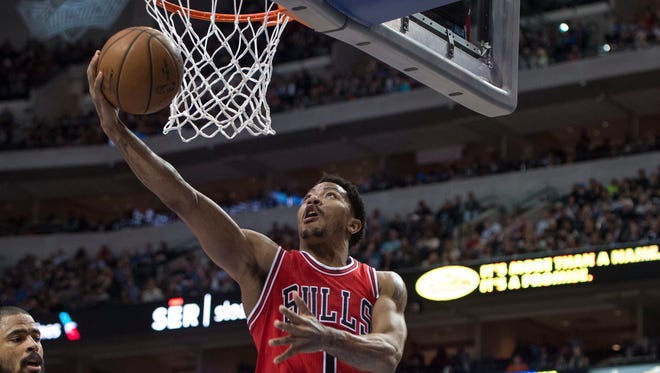 Chicago Bulls guard Derrick Rose (1) drives to the basket during the first half against the Dallas Mavericks at the American Airlines Center.