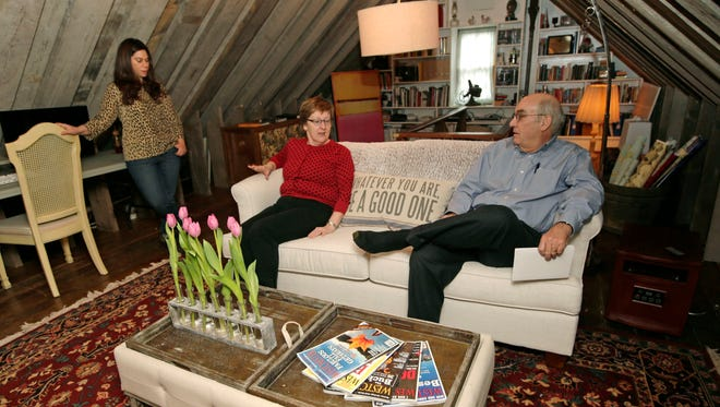 In this Sunday, Jan. 12, 2014, photo, Rebecca Gwynne, left, of Tuckahoe, N.Y., answers a question as Marijane Hamren inspects Gwynne's Simplicity Sofa with her husband Jim Hamren, in Tuckahoe, N.Y.  While SimplicityÂ?s furniture is sold only over the Internet, some customers want to see and try out the sofas and chairs. Owner Jeff Frank contacts people who have already bought his furniture, and asks them if theyÂ?ll let a prospective customer stop by to take a look.